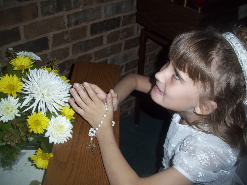 During the offeratory Nadia was one of the girls that brought up a basket of flowers.